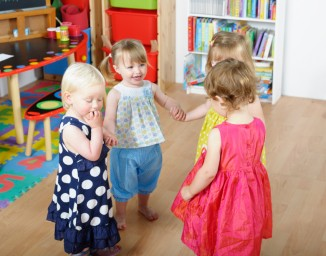 group-of-happy-toddlers-holding-hands-while-playing
